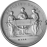A silver replica of his gold Poetry Medal, a round medal showing three people with the words 'Honoris Causa' above.