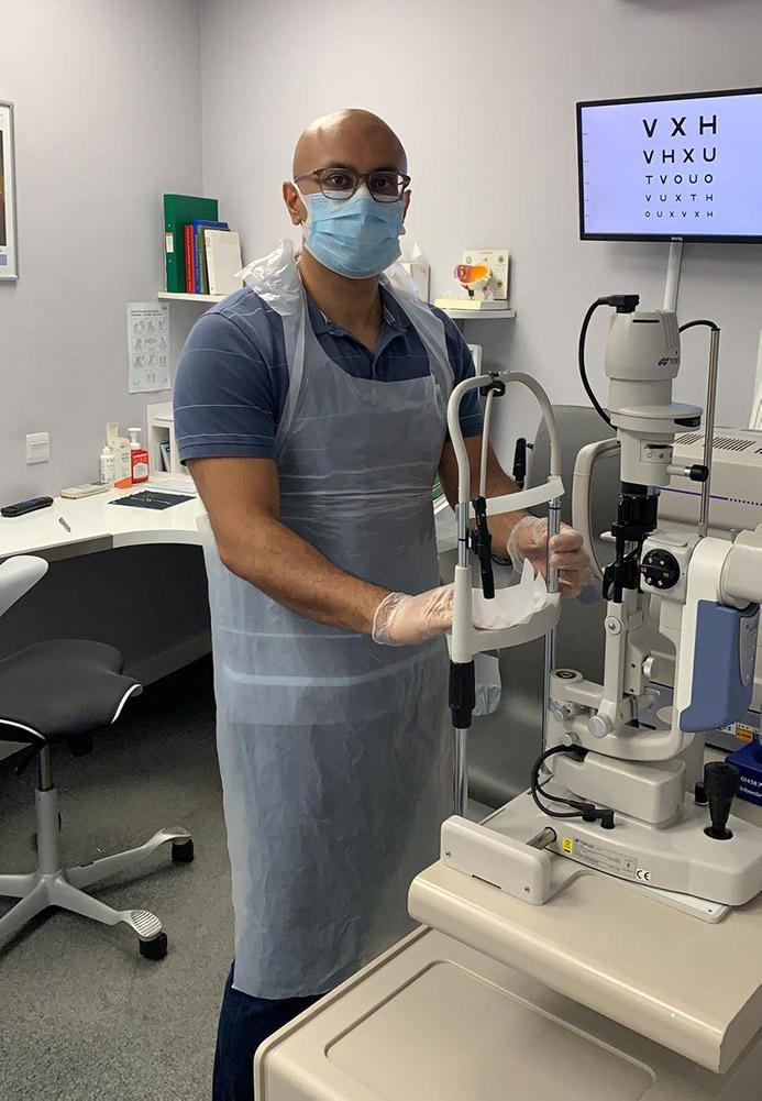 Saagar Hirani cleans equipment.